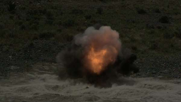 Fiery explosion in slow motion at blasting area; ground shockwave visible. Green Beret United States Army Special Forces. Royalty-free stock video