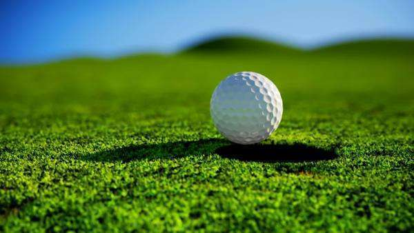 Animation of golf ball falling into a hole Royalty-free stock video