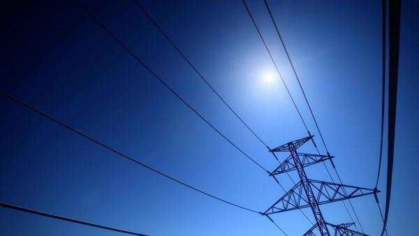 Electricity pylons and lines against a clear blue sky Royalty-free stock video