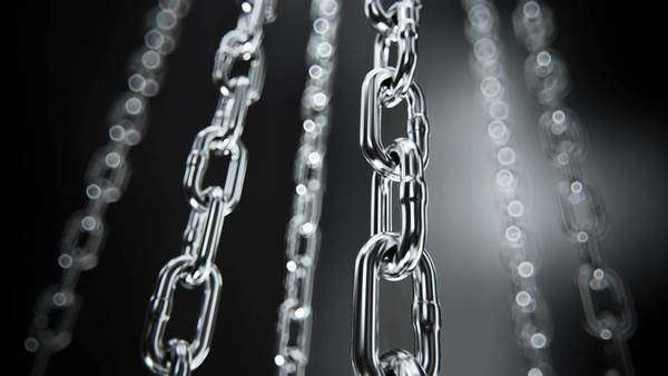 Reflective chrome chain moving on a dark background Royalty-free stock video