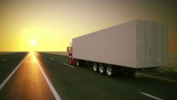 Large delivery truck is moving towards a setting sun Royalty-free stock video
