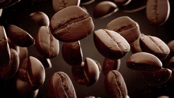 Slow motion CG animation of roasted coffee beans with coffee dust falling down in front of a dark background Royalty-free stock video
