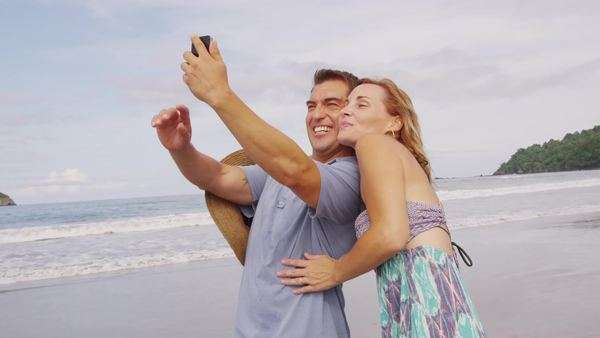 Couple taking photo together at beach, Costa Rica Royalty-free stock video