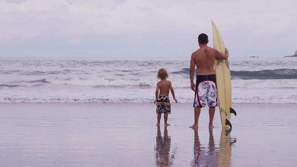 Father and son at beach with surfboard Royalty-free stock video