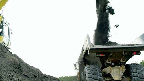Slow motion shot of hydraulic shovel loading coal on truck Royalty-free stock video