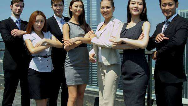 Portrait of confident team Asian Chinese Caucasian corporate business partners standing office rooftop downtown city shot on RED EPIC Royalty-free stock video