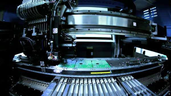 Close up of automated machine manufacturing PCBs operated by Chinese workers, Mainland China, East Asia Royalty-free stock video