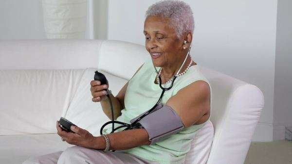 Senior African American woman checking her blood pressure Royalty-free stock video
