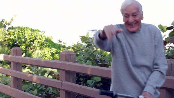 Senior Caucasian man with bicycle waving Royalty-free stock video