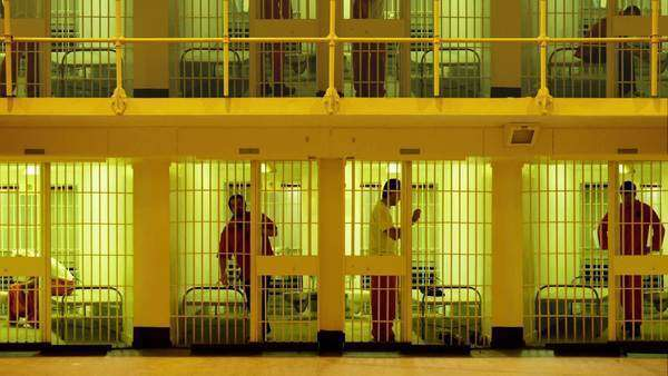 Prisoners serving time in a large cell block Royalty-free stock video