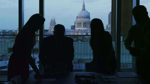 Business group in silhouette shake hands at the end of a meeting Royalty-free stock video