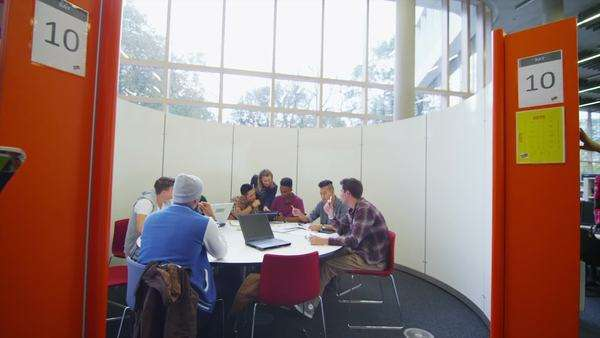 Diverse student group working and studying together in college library. Royalty-free stock video