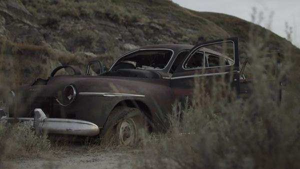Tracking shot of abandoned car in desert Royalty-free stock video