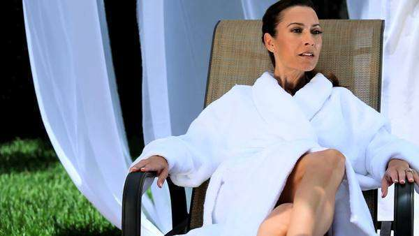 Sophisticated lady relaxing at a luxury health and beauty spa. Royalty-free stock video