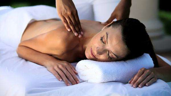 Sophisticated lady having massage treatment at a luxury health & beauty spa. Royalty-free stock video