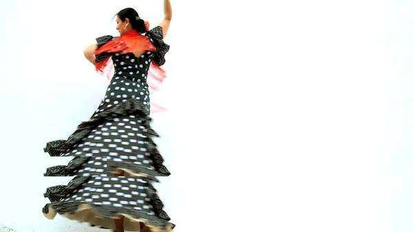 Dramatic female dancing traditional Spanish flamenco against white background, Seville, Spain 60FPS. Royalty-free stock video