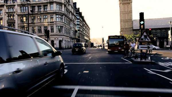 Point-of view driving through London's Westminster Square and past Big Ben in early morning. Royalty-free stock video