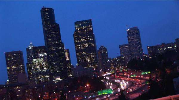 An angled view of Seattle's downtown skyline at night with traffic. Royalty-free stock video
