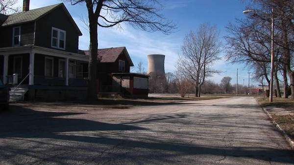 Residential homes are located near a nuclear power plant. Royalty-free stock video