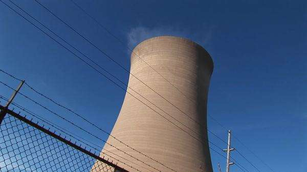 Steam drifts slowly from the top of a nuclear power plant. Royalty-free stock video