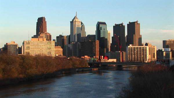The skyline of Philadelphia towers above the Schuylkill River. Royalty-free stock video