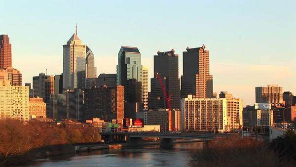 The skyline of Philadelphia towers above of the Schuylkill River. Royalty-free stock video