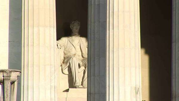 Close-up of Lincoln Memorial in Washington, DC shows statue of President Abraham Lincoln behind classic Greek columns. Royalty-free stock video