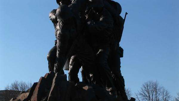 The camera slowly pans up the Iwo Jima Marine Corps Memorial statue. Royalty-free stock video