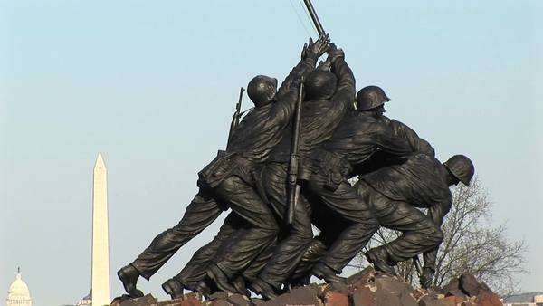 The Iwo Jima Marine Corps Memorial proudly holds up an American flag. Royalty-free stock video