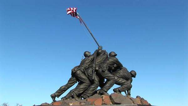 An American flag waves with the breeze at the top of the Iwo Jima Marine Corps Memorial in Washington D.C. Royalty-free stock video