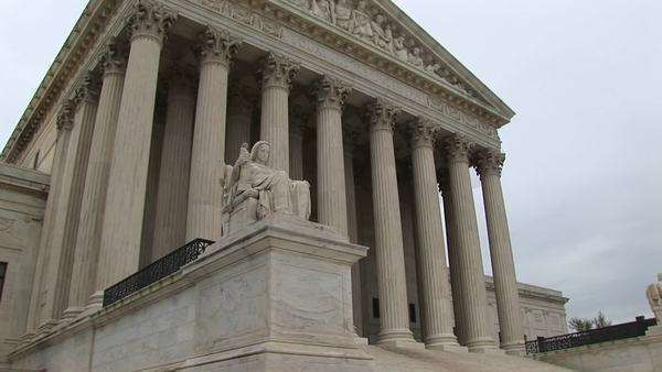 A worms-eye view of stairs and columned entrance to the Supreme Court. Royalty-free stock video