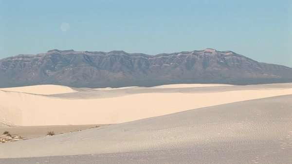 Long-shot of mountains and sand dunes at White Sands National Monument in New Mexico Royalty-free stock video