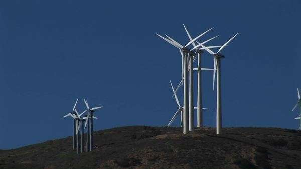 Long-shot of several wind turbines generating power in Tehachapi, California. Royalty-free stock video