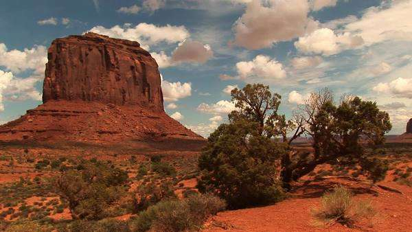 Long-shot of a sandstone formation at Monument Valley Tribal Park in Arizona and Utah. Royalty-free stock video