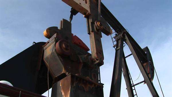 Close-up of an oil pump turning in the New Mexico desert. Royalty-free stock video