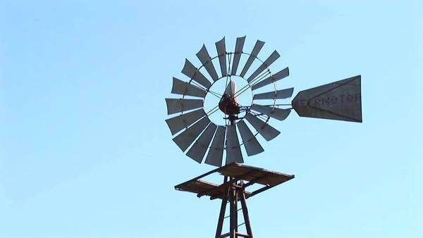 Close-up of a windmill turning in the breeze. Royalty-free stock video
