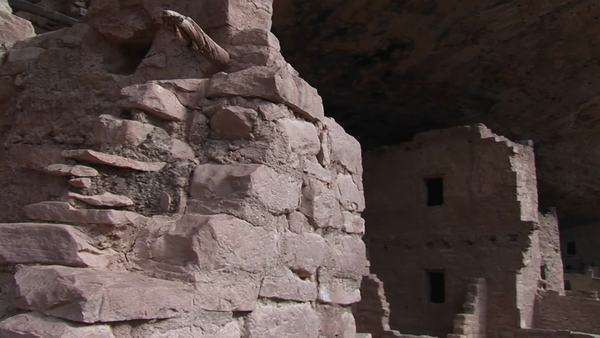 Medium shot of the ruins of Native American cliff dwellings in Mesa Verde National Park. Royalty-free stock video