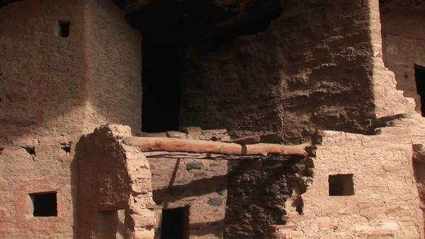 Pan-down to the ruins of Native American cliff dwellings in Mesa Verde National Park. Royalty-free stock video