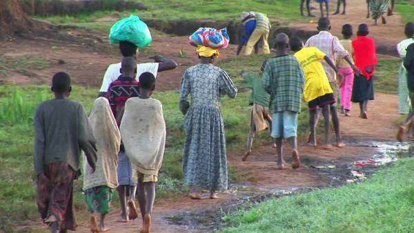 Villagers and children walk along a path in Uganda, Africa. Royalty-free stock video
