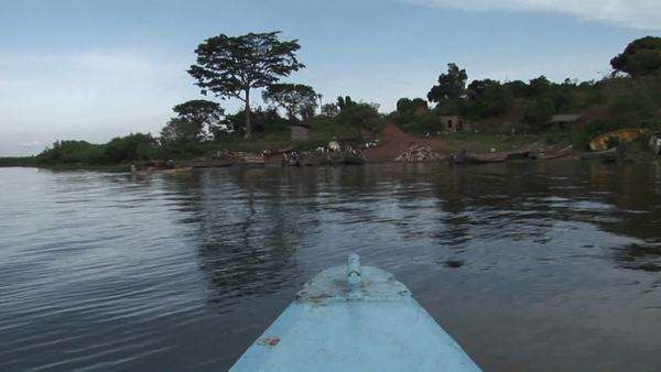 A fishing boat departs from the shore of Lake Victoria in Uganda. Royalty-free stock video