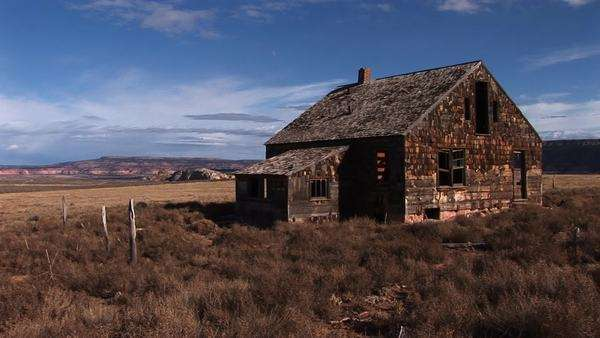Medium shot of an old abandoned homestead a lonely prairie. Royalty-free stock video