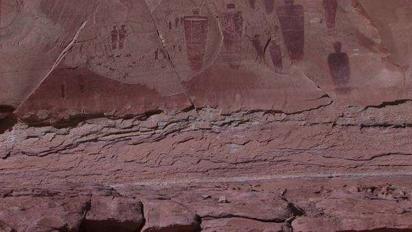 Pan-up of remarkable American Indian petroglyph's on a desert cliff. Royalty-free stock video
