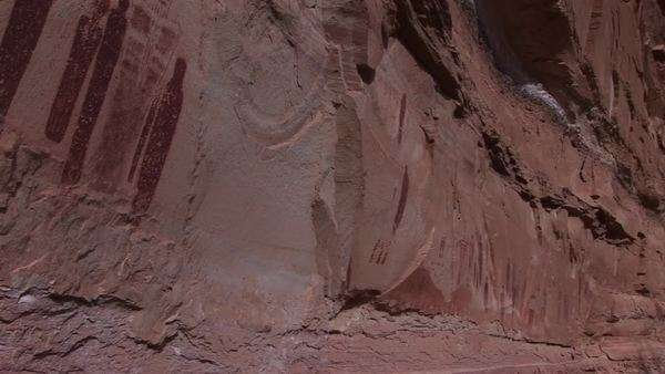 Pan-left across American Indian petroglyph's on a canyon wall. Royalty-free stock video