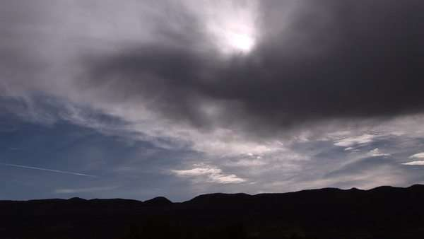 Long shot of sunlight shining through storm clouds. Royalty-free stock video