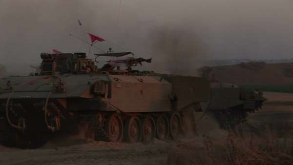 Israeli armored personnel carriers.roll into battle along the border with the Gaza Strip. Royalty-free stock video