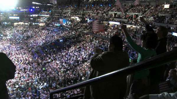 A packed stadium at Pepsi Center clap and cheer as Bill Clinton delivers a pro Barack Obama speech at the 2008 Democratic National Convention in Denver, Colorado. Royalty-free stock video