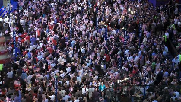 The crowd at Pepsi Center gives former President Bill Clinton a standing ovation as they wave flags and cheer during the Democratic National Convention in Denver, Colorado. Royalty-free stock video