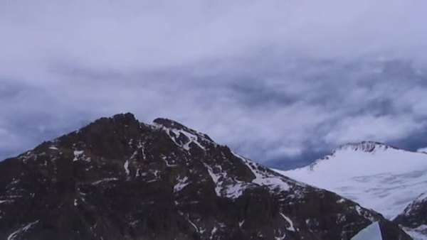 Timelapse of clouds moving over two summit peaks near Mt. Everest Royalty-free stock video