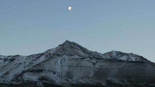 A full moon rises over the Andes mountains in Patagonia. Royalty-free stock video