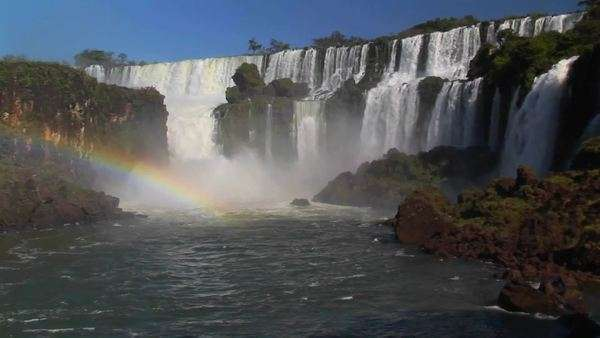 A beautiful wide shot of Iguacu Falls with a rainbow foreground. Royalty-free stock video